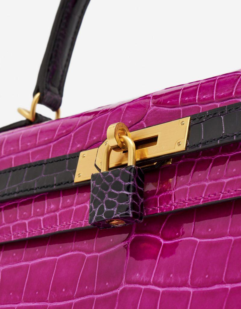 Hardware detail of a pre-loved Hermès Kelly 35 HSS Crocodile Porosus Rose Scheherazade / Aubergine on SACLÀB