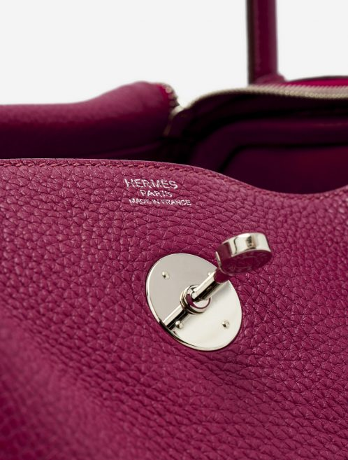 Hardware detail of a pre-loved Hermès Lindy 30 Taurillon Clemence Rubis on SACLÀB