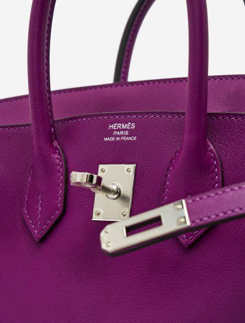 Hardware details of a pre-loved Hermès Birkin 25 Swift Anemone on SACLÀB