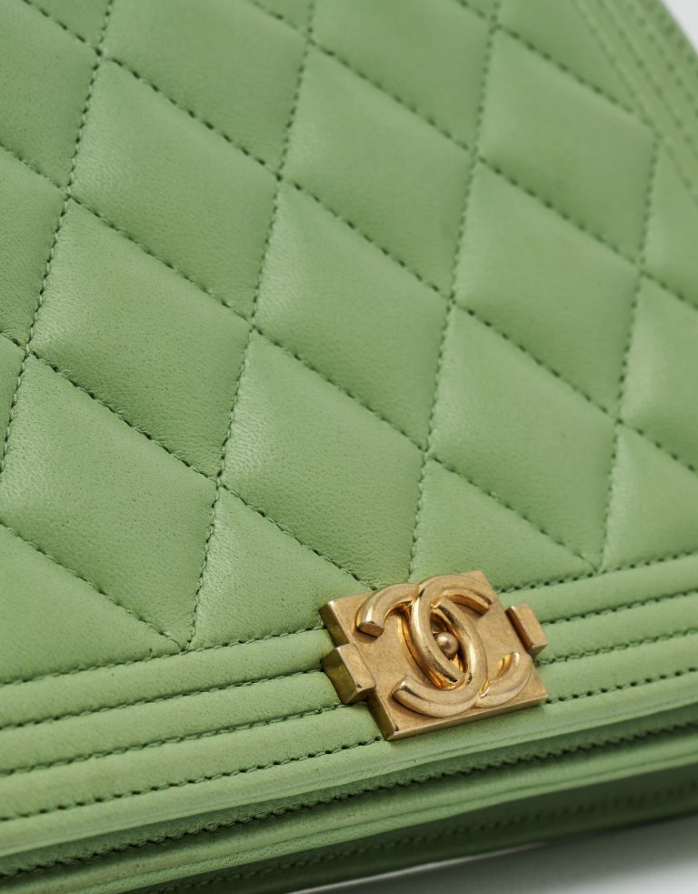 Gold Chanel Hardware Detail of a pre-loved Chanel Boy Wallet on Chain Lambskin in Light Green on SACLÀB