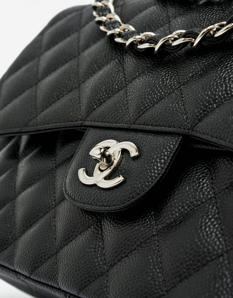 Silver hardware detail of a pre-loved Chanel Timeless Jumbo Caviar leather in Black on SACLÀB