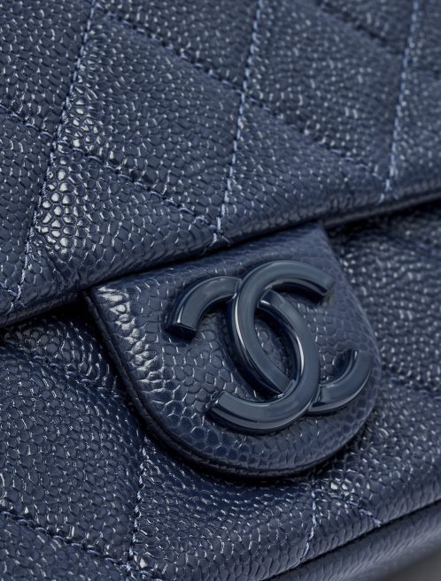Hardware detail of a pre-loved Chanel Timeless Mini Caviar Blue Incognito on SACLÀB