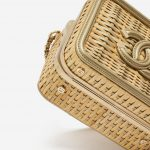 A pre-loved small Chanel Vanity Case in Beige Straw and Gold Leather on SACLÀB