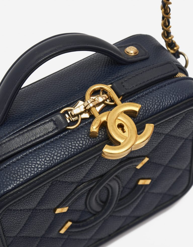 CC Charm Detail on a pre-loved Chanel Vanity Case Small Caviar Leather in Dark Blue on SACLÀB
