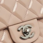A pre-loved Chanel Timeless Mini Square in Nude Patent Leather on SACLÀB