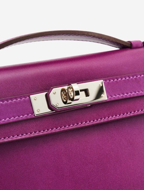 A pre-loved Hermès Kelly Cut Clutch in Anemone Swift Leather on SACLÀB