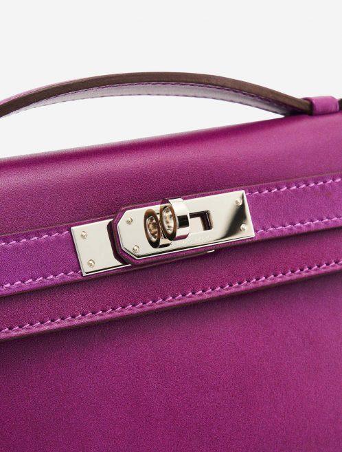 A pre-loved Hermès Kelly Cut Clutch in Anemone Swift Leather on SACLÀB