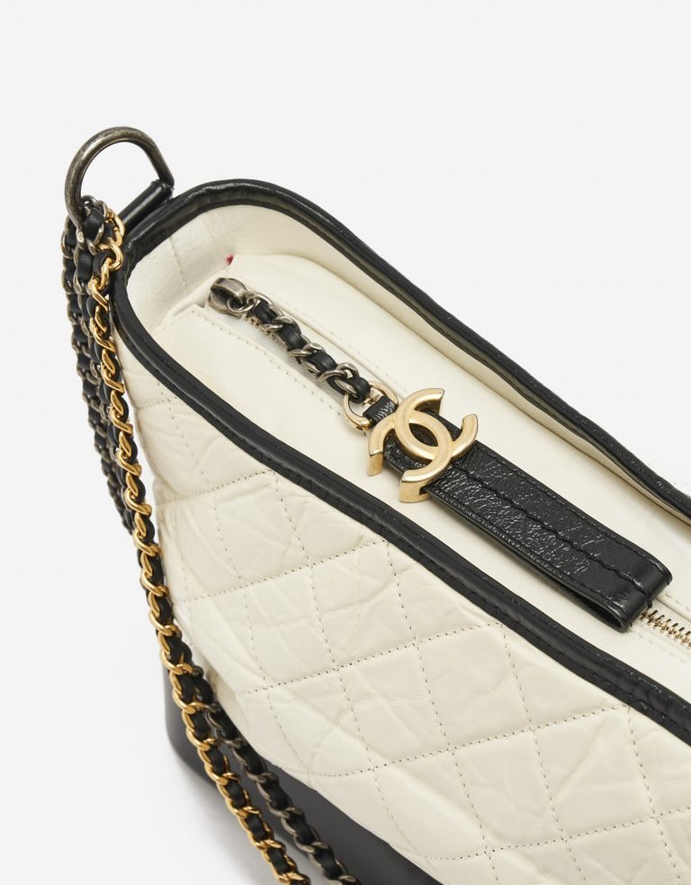 Hardware Details on a black and white Chanel Gabrielle Bag Large on SACLÀB