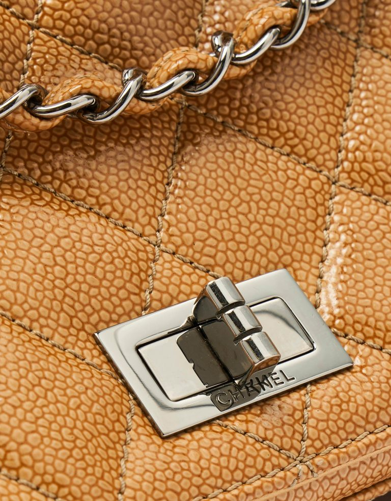 A pre-loved Chanel 2.55 Medium in Beige Caviar Patent Leather on SACLÀB
