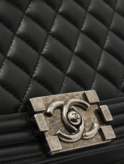 CC Logo Detail on a pre-loved Chanel Boy Medium Lambskin Black on SACLÀB