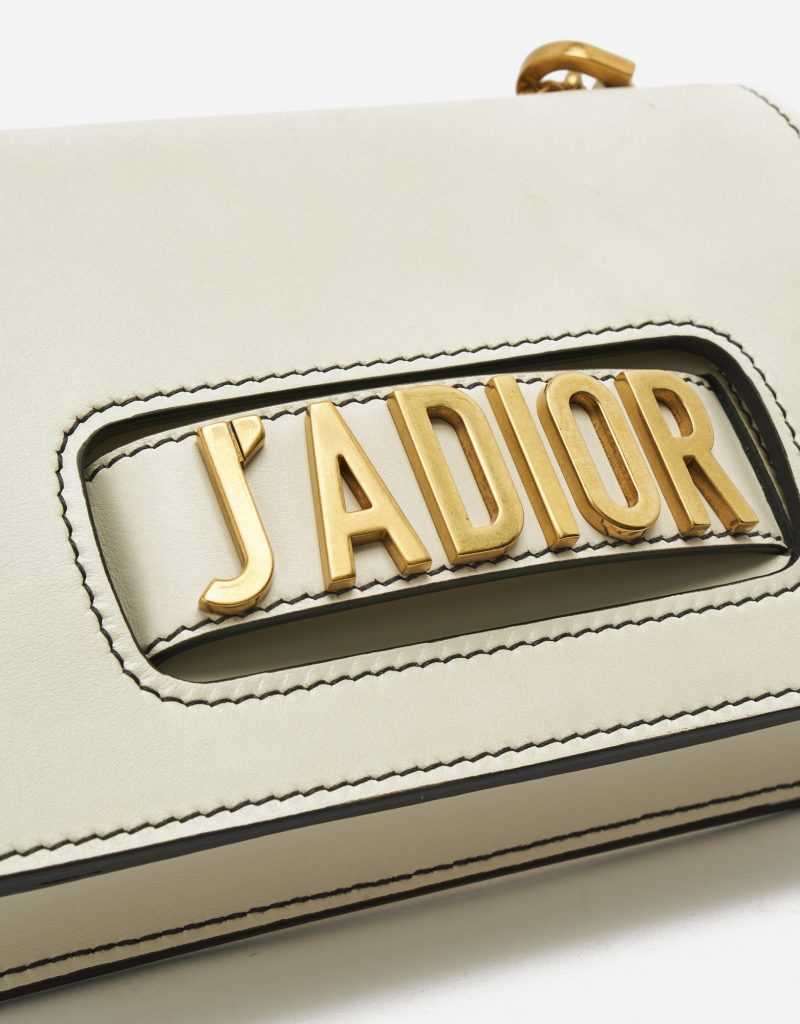 Logo Detail on a pre-loved Dior J'ADIOR Medium Calfskin Beige on SACLÀB