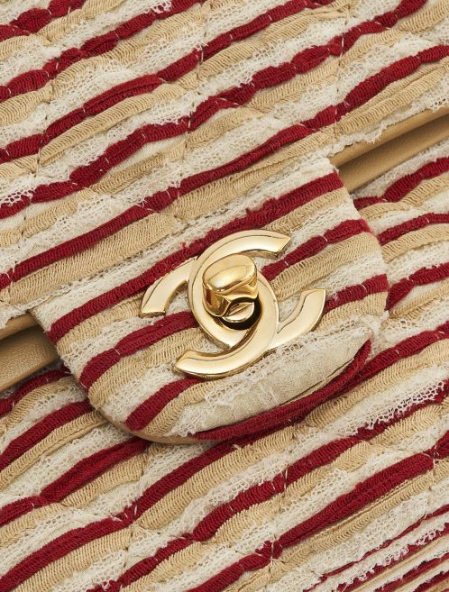 Gold hardware detail on a limited-edition Chanel Timeless Medium made from Fabric and Pearls in Red and White on SACLÀB