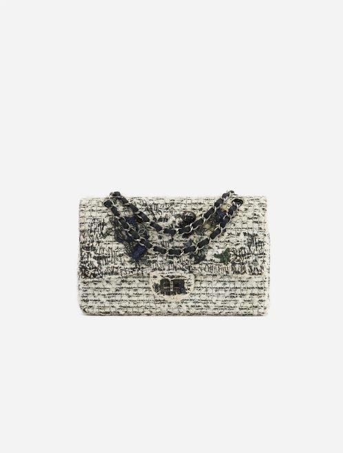 A pre-loved Chanel 2.55 Reissue 226 Tweed White Black Garden Charms on SACLÀB