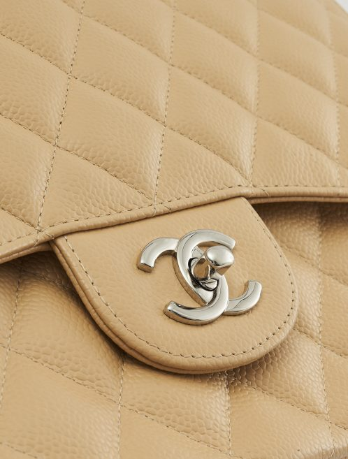 A pre-loved Chanel Timeless Jumbo Caviar Beige on SACLÀB