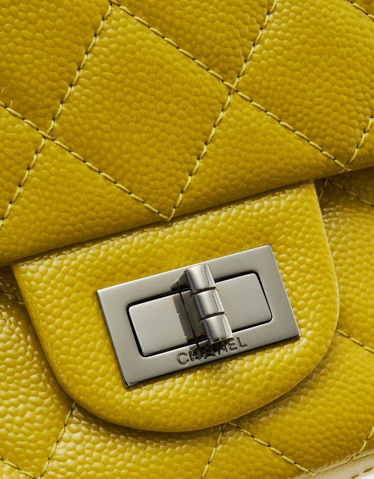 A pre-loved Chanel 2.55 Reissue 227 Patent Caviar Yellow on SACLÀB