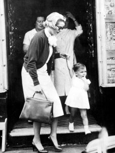HMXBKE Princess Grace holds the hand of her daughter, Princess Caroline, during a shopping trip in the Avenue des Moulins in Monte Carlo.