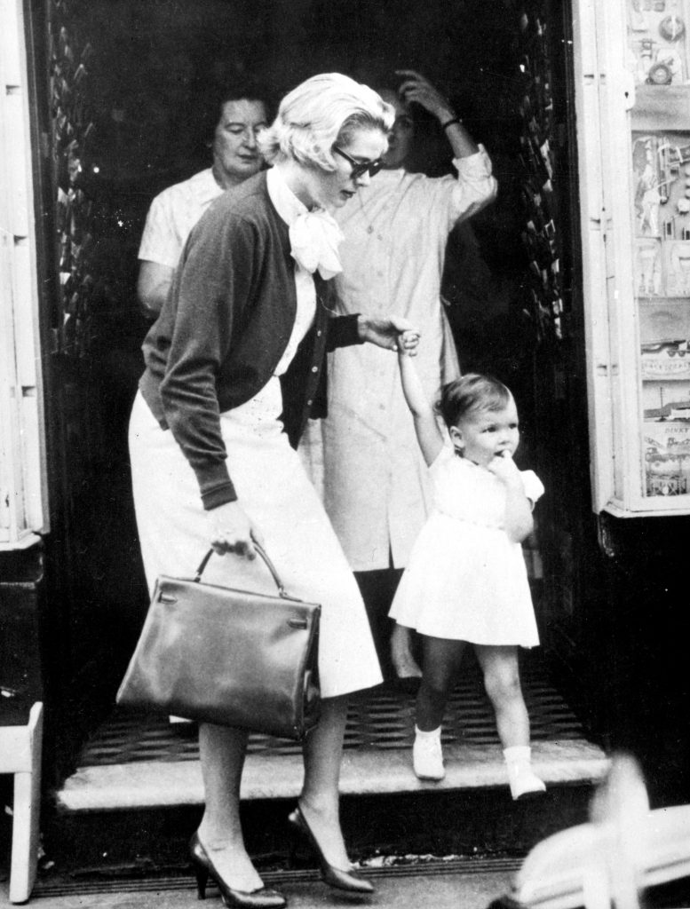 Princess Grace holds the hand of her daughter, Princess Caroline, during a shopping trip in the Avenue des Moulins in Monte Carlo.